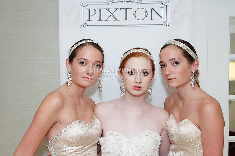 Close up of models posing in (left to right) Elinor, Elizabeth, and Marianne wedding gowns from the Pixton Couture Bridal Spring 2014 collection, by Kimberly Pixton Millar, during New York Bridal Market Week Spring 2014.