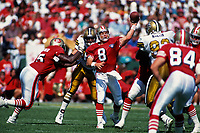 SAN FRANCISCO, CA:  Quarterback Steve Young of the San Francisco 49ers in action during a game against the New Orleans Saints at Candlestick Park in San Francisco, California on September 25, 1994. (Photo by Brad Mangin)
