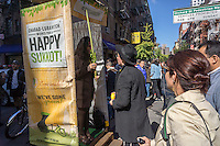 "Lubavitchers set up a portable ""sukkah-mobile"", complete with etrogs (citron) and lulav branches for Jewish passer-by in the Lower east Side neighborhood of New York on Sunday, October 4, 2015.  (© Richard B. Levine)"