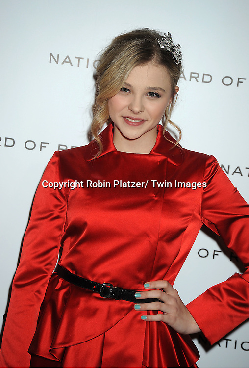 actress Chloe Moretz in red Miu Miu dress attends The National Board of Review Film Awards Gala on January 10, 2012 at Cipriani 42nd Street in New York City.