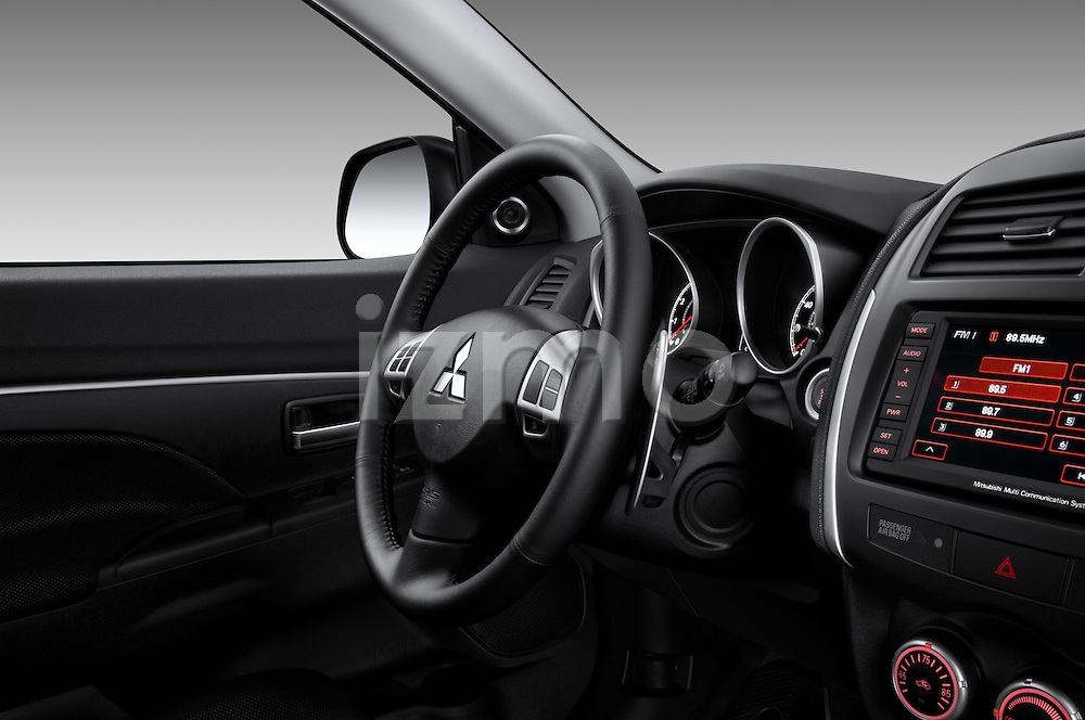 Steering wheel and dashboard detail of a 2011 Mitsubishi Outlander Sport SE