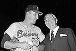 Pittsburgh PA: View of Warren Spahn signing an autograph baseball for a local businessman at the annual HYPO game at Forbes Field - 1965.<br /> The money raised by HYPO (Help Young Players Organize) was used to help local communities buy equipment and build ball fields