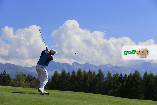 Michael HOEY (NIR) plays his 2nd shot on the 12th hole during Saturday's Round 3 of the 2014 Omega European Masters held at the Crans Montana Golf Club, Crans-sur-Sierre, Switzerland.: Picture Eoin Clarke, www.golffile.ie: 6th September 2014