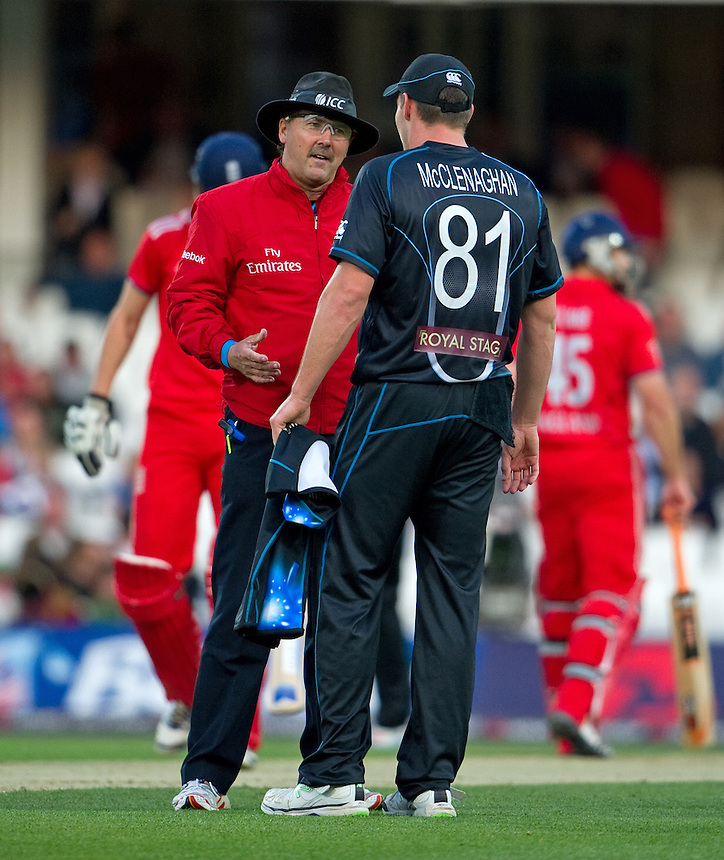 Umpire Richard Illingworth speaks with New Zealand's Mitchell McClenaghan<br /> <br />  (Photo by Ashley Western/CameraSport) <br /> <br /> International Cricket - NatWest International T20 Series - England v New  Zealand - Tuesday 25th June 2013 - The Kia Oval, London <br /> <br />  &copy; CameraSport - 43 Linden Ave. Countesthorpe. Leicester. England. LE8 5PG - Tel: +44 (0) 116 277 4147 - admin@camerasport.com - www.camerasport.com