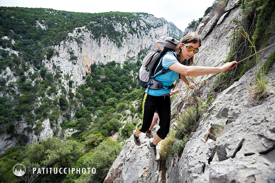 Janine Patitucci hiking the Selvaggio Blu in Sardinia. The trail is perhaps Italy's most remote trek and requires some climbing skill by the hikers