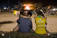 BENICÀSSIM, SPAIN - Young Spaniards embrace during a performance by English band Leftfield at the Festival's main stage...Described by some as a Mediterranean Glastonbury, the Festival Internacional de Benicàssim (FIB) is the largest music festival outside the UK to target British visitors. In 2010, seven of the eight main headline slots were filled by English bands...A small coastal town of 13,000 inhabitants, Benicàssim hosted some 200,000 visitors in 2009, with 40% of those believed to be coming from the UK. In 2010, attendances fell to 127,000 visitors but the percentage of UK visitors is believed to have risen.