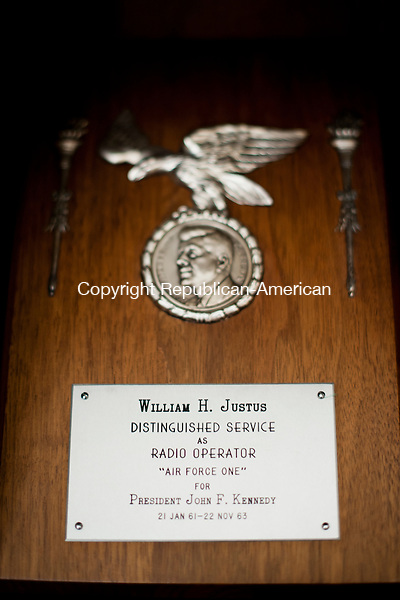 TORRINGTON, CT - 20 November 2013-112013EC02--     Bill Justus has several plaques for his service on Air Force One. The Torrington man was the chief of communications on Air Force One from 1962-1975, which included four presidents. Justus remembers carrying JFK's casket from Dallas. He said Kennedy was his favorite boss. Erin Covey Republican American.
