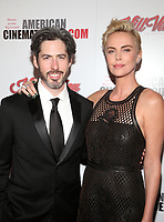 BEVERLY HILLS, CA - NOVEMBER 8: Jason Reitman, Charlize Theron, 33rd American Cinematheque Award Presentation Honoring Charlize Theron at The Beverly Hilton Hotel in Beverly Hills, California on November 8, 2019. Credit Faye Sadou/MediaPunch