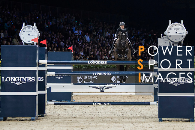 Reed Kessler of the USA riding Tradition de la Roque competes in the Longines Grand Prix during the Longines Masters of Hong Kong at AsiaWorld-Expo on 11 February 2018, in Hong Kong, Hong Kong. Photo by Diego Gonzalez / Power Sport Images