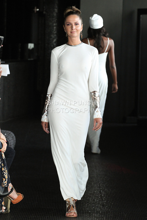 Delphine walks runway in a long matter jersey Niara gown from the Carlton Jones Resort 2017 collection fashion show at Le Bain in The Standard Hotel in New York City, on June 8, 2017.