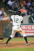 Anfernee Seymour (12) of the Greensboro Grasshoppers at bat against the Kannapolis Intimidators at NewBridge Bank Park on July 7, 2016 in Greensboro, North Carolina.  The Dash defeated the Pelicans 13-9.  (Brian Westerholt/Four Seam Images)
