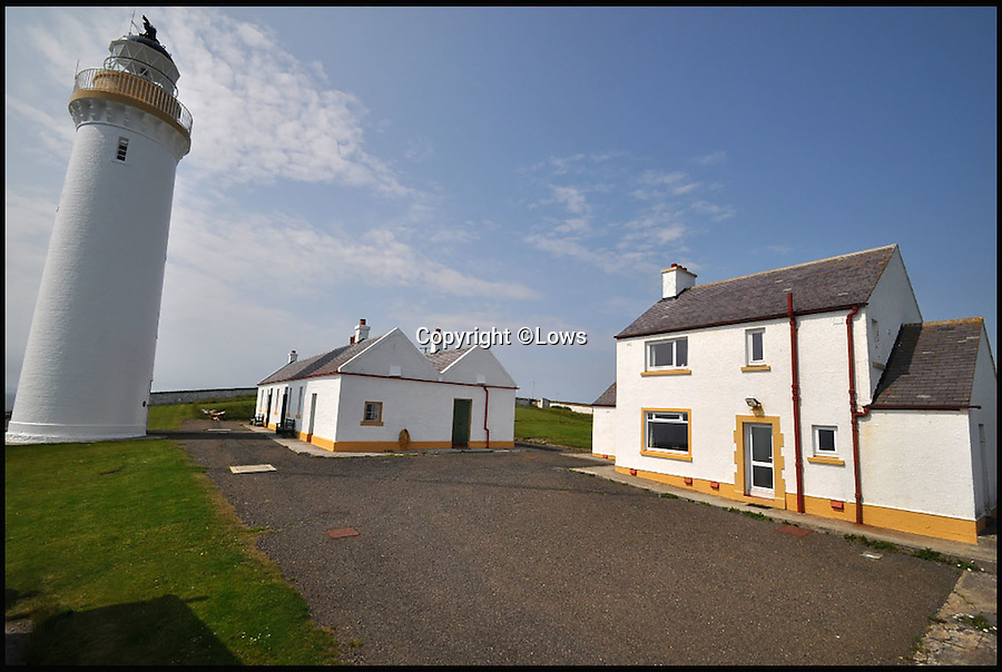 BNPS.co.uk (01202 558833)<br /> Pic: Lows/BNPS<br /> <br /> To the Lighthouse? - for sale stunning property perched above the storm tossed Pentland firth.<br /> <br /> This stunning 19th century lighthouse boasts breathtaking views but you'll need to close the curtains at night if you buy it as the light is still operational. <br /> <br /> Cantick Head Lighthouse on the remote Scottish island of Hoy is perched perilously on top of a 115ft cliff, with spectacular views over a strait of water separating the Orkney Islands and the mainland. <br /> <br /> Built in 1856 it was manually operated for 135 years, at which point it was sold and converted, along with two adjacent buildings, into a holiday rental. <br /> <br /> All three residences, which together comprise seven bedrooms, are being sold for £275,000.