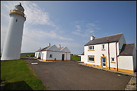 BNPS.co.uk (01202 558833)<br /> Pic: Lows/BNPS<br /> <br /> To the Lighthouse? - for sale stunning property perched above the storm tossed Pentland firth.<br /> <br /> This stunning 19th century lighthouse boasts breathtaking views but you'll need to close the curtains at night if you buy it as the light is still operational. <br /> <br /> Cantick Head Lighthouse on the remote Scottish island of Hoy is perched perilously on top of a 115ft cliff, with spectacular views over a strait of water separating the Orkney Islands and the mainland. <br /> <br /> Built in 1856 it was manually operated for 135 years, at which point it was sold and converted, along with two adjacent buildings, into a holiday rental. <br /> <br /> All three residences, which together comprise seven bedrooms, are being sold for &pound;275,000.