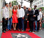 "Actors Raymond Cruz, Phillip P. Keene, Kyra Sedgwick, Anthony John Denison, Robert Gossett, Michael Paul Chan, G.W. Bailey, Corey Reynolds pose for photo with US actress Kyra Sedgwick as she receives the 2,384th Star on the Hollywood Walk of Fame, Los Angeles, California, USA, on June  8, 2009. Bacon's star is next to hers. Kyra Sedgwick was born in New York in 1965 and grew up in Manhattan.  She made her professional acting debut at the age of 16 on the soap opera ""Another World."" .Photo by Nina Prommer/Milestone Photo"