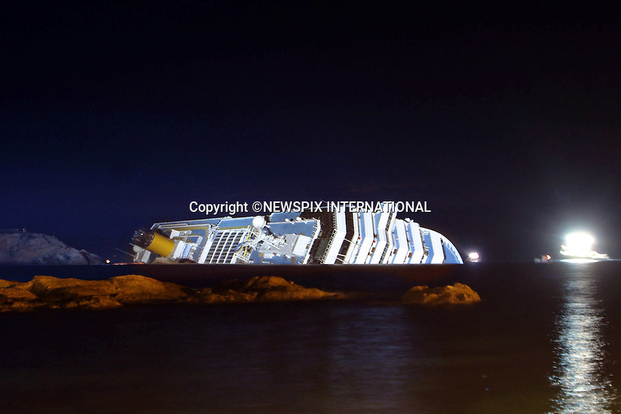 """Isola di Giglio, Italy_17/01/2012:  COSTA CONCORDIA CRUISE TRAGEDY.The luxury cruise ship Costa Concordia, that ran aground on Friday night near Isola del Giglio..The Costa Concordia which was carrying 4,200 people, experienced trouble a few hundred metres from the tiny Tuscan holiday island of Giglio on Friday evening as the passengers were at dinner, after apparently sailing off course..Mandatory Credit Photo: ©Bramo/NEWSPIX INTERNATIONAL..**ALL FEES PAYABLE TO: """"NEWSPIX INTERNATIONAL""""**..IMMEDIATE CONFIRMATION OF USAGE REQUIRED:.Newspix International, 31 Chinnery Hill, Bishop's Stortford, ENGLAND CM23 3PS.Tel:+441279 324672  ; Fax: +441279656877.Mobile:  07775681153.e-mail: info@newspixinternational.co.uk"""