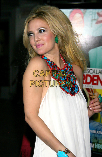 """DREW BARRYMORE.""""Grey Gardens"""" Los Angeles Premiere held at Grauman's Chinese Theatre, Hollywood, California, USA..April 16th, 2009.half length green black pink teased big hair messy tousled lipstick eyeliner white red blue detail halterneck collar beads beaded earrings dress.CAP/ADM/MJ.©Michael Jade/AdMedia/Capital Pictures."""