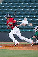Jairo Beras (5) of the Hickory Crawdads follows through on his swing against the Savannah Sand Gnats at L.P. Frans Stadium on June 15, 2015 in Hickory, North Carolina.  The Crawdads defeated the Sand Gnats 4-1.  (Brian Westerholt/Four Seam Images)