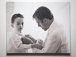 © Joel Goodman - 07973 332324 . 24 June 2013 . Orchid Suite , Beetham Tower , Manchester , UK . Photographs of Phil Neville with his children on a hallway wall . Former triplex apartment home of Phil and Julie Neville , which is up for rent and thought to be the most expensive in Manchester . Photo credit : Joel Goodman