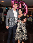 Carmel O'Brien celebrating her 50th birthday with her husband Brendan in Daly's of Donore. Photo:Colin Bell/pressphotos.ie