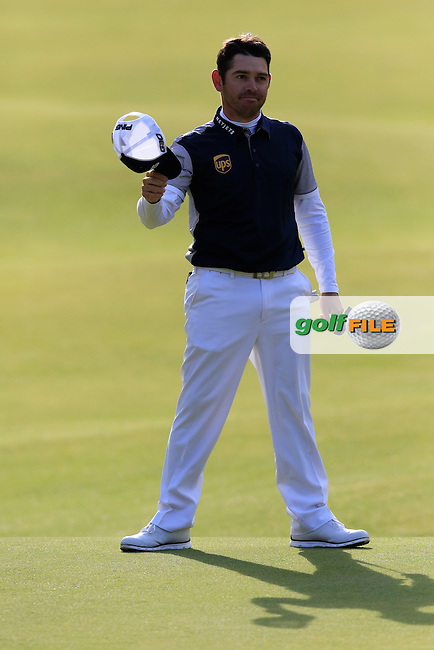 Louis Oosthuizen (RSA) sinks his birdie putt to tie for the lead on the 18th green during Sunday's Round 3 of the 144th Open Championship, St Andrews Old Course, St Andrews, Fife, Scotland. 19/07/2015.<br /> Picture Eoin Clarke, www.golffile.ie