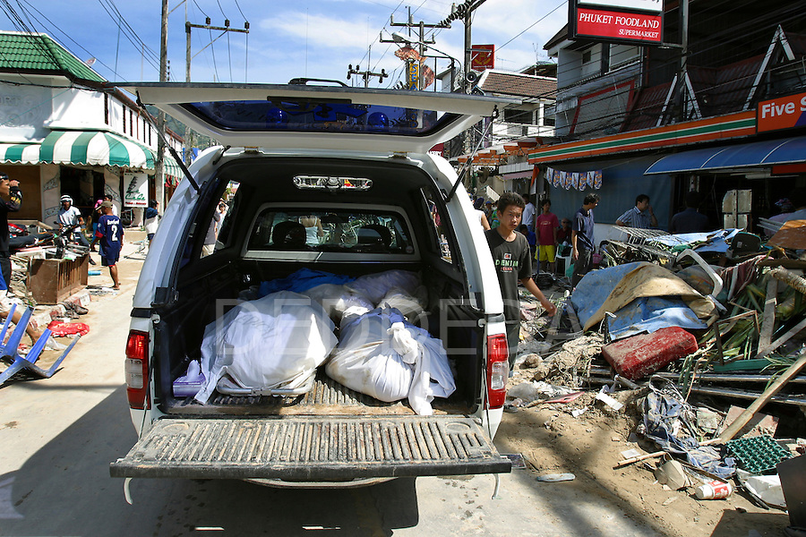 Dead bodies are collected in the back of a truck at Patong Beach two days after tsunamis hit the west coast of Thailand. On December 26, 2004, a major earthquake generated tsunamis that ravaged coastlines from Southeast Asia to Africa. Approximately 275,000 people were killed and tens of thousands were left homeless, making it one of the deadliest natural disasters in modern history.
