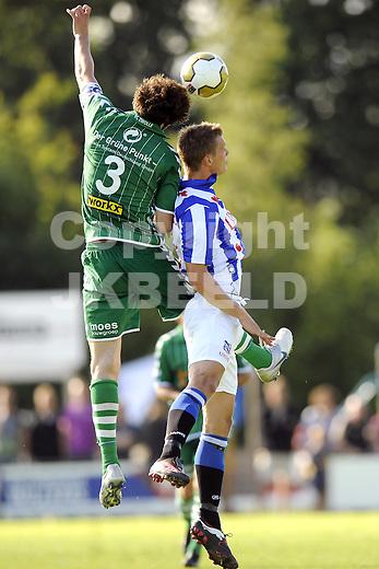 voetbal fc zwolle - sc heerenveen 17-07-2010 oefenwedstrijd seizoen 2010-2011 eric botteghin wint kopduel van viktor elm