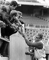"Jim ""Catfish"" Hunter signs autographs for kids before <br />