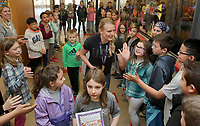 NWA Democrat-Gazette/DAVID GOTTSCHALK Former University of Arkansas pole vaulter Sandi Morris is greeted Friday, March 9, 2018, by the entire student body in the hallways at Butterfield Trail Elementary School in Fayetteville. Morris recently returned from the 2018 IAAF World Indoor Championships in Birmingham, England where she won the gold medal in pole vault. Morris was given a homecoming at the school that included signs, chants, autographs and high fives as she was greeted by the students.