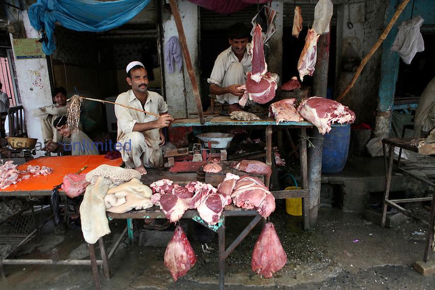 Butchers in their market, Pakistan