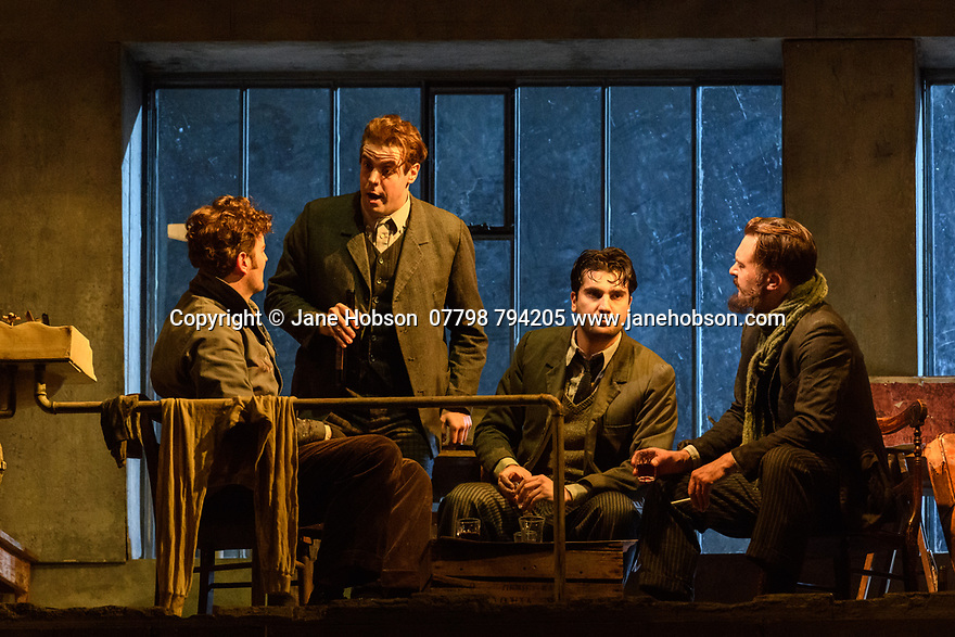"London, UK. 24.11.2018. English National Opera present their fourth revival of Jonathan Miller's production of Puccini's ""La Boheme"", in which Natalya Romaniw makes her ENO debut. Cast is: Natalya Romaniw (Mimi), Jonathan Tetelman (Rodolfo), Nicholas Lester (Marcello), Simon Butteriss (Benoit/Alcindoro), Nadine Benjamin (Musetta), David Soar (Colline), Bozidar Smiljanic (Schaunard). Picture shows: Nicholas Lester (Marcello), Bozidar Smiljanic (Schaunard), Jonathan Tetelman (Rodolfo), David Soar (Colline). Photograph © Jane Hobson."