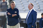Head coach Mark Stoops of the Kentucky Wildcats talks with head coach Paul Johnson of the Georgia Tech Yellow Jackets prior to the TaxSlayer Bowl at EverBank Field on Saturday, December 31, 2016 in Jacksonville, Florida. Photo by Michael Reaves | Staff.