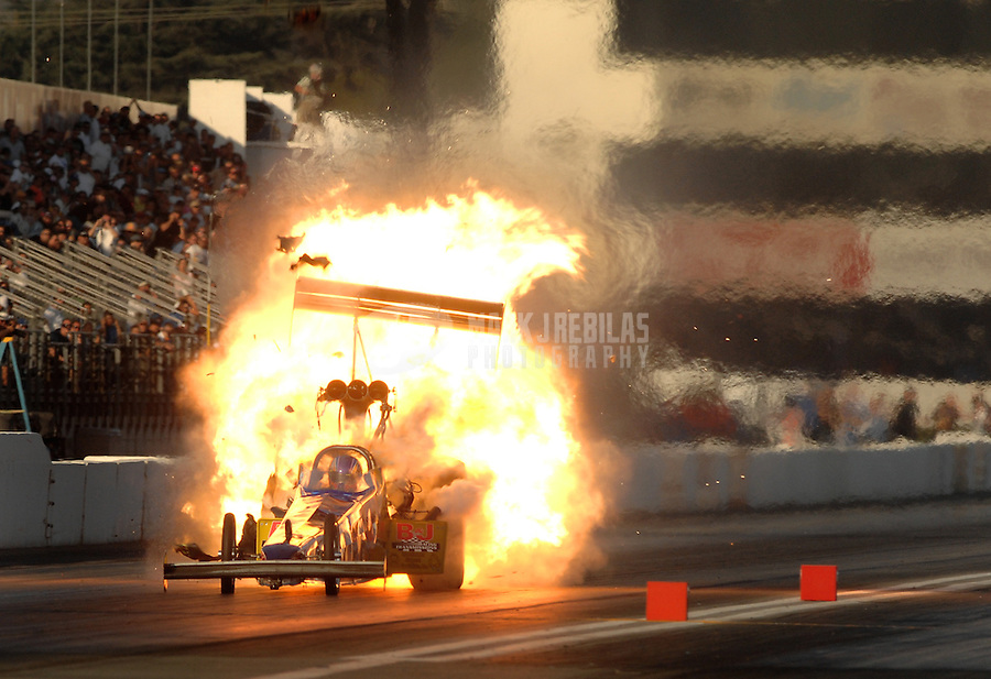 Nov 3, 2007; Pomona, CA, USA; NHRA top fuel dragster driver Mike Strasburg explodes an engine during qualifying for the Auto Club Finals at Auto Club Raceway at Pomona. Mandatory Credit: Mark J. Rebilas-US PRESSWIRE