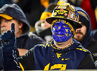 Morgantown, WV - NOV 19, 2016: A West Virginia Mountaineers fan puts up the number one sign during game between West Virginia and Oklahoma at Mountaineer Field at Milan Puskar Stadium Morgantown, West Virginia. (Photo by Phil Peters/Media Images International)