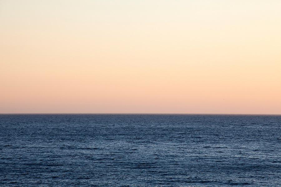 Sunset over the deep blue Pacific Ocean in Malibu, California, USA