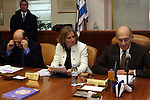 """Outgoing Israeli Prime Minister Ehud Olmert (R), Foreign Minister and Kadima leader Tzipi Livni (C) and Transportation Minister Shaul Mofaz (L), attend the weekly cabinet meeting in the Knesset in Jerusalem, Sunday, February 22, 2009. In the meeting, Ehud Olmert congratulated Likud leader Benjamin Netanyahu for being entrusted with the """"complex"""" task of forming a coalition and urged him to act as quickly and as efficiently as possible in creating the government. Photo By: Tess Scheflan / JINI."""