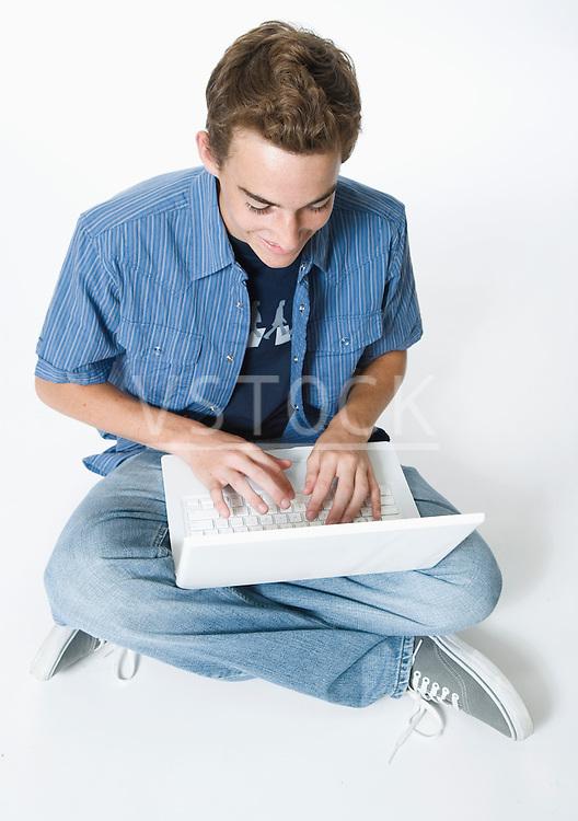Teenage boy using laptop