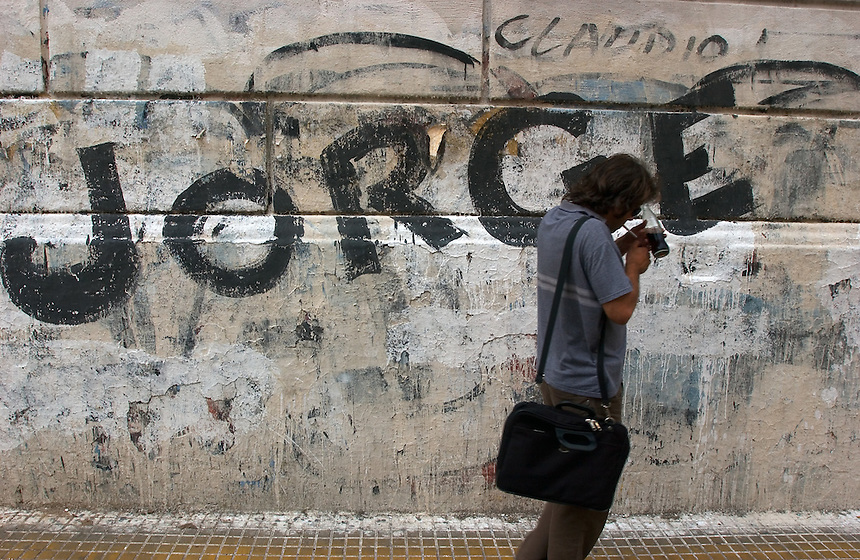 Graffitti lines a wall in the Buenos Aires neighborhood of San Telmo. Magic realist author Jorge Luis Borges influenced the work of many of the western hemisphere's greatest writers. (Kevin Moloney for the New York Times)