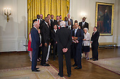 United States President Barack Obama, with Vice President Joseph Biden (L), greets former players and staff of the 1983 NCAA National Basketball Championship North Carolina State Wolfpack in the East Room of the White House in Washington, DC, USA, 09 May 2016. The President and Vice President met briefly with members of the team and their families in the East Room. The team was previously unable to visit the White House to be recognized for their championship.<br /> Credit: Shawn Thew / Pool via CNP