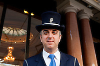 Fabrice, a doorman at the Hotel de Paris, poses for the photographer at the entrance to the hotel, Casino Square, Monte Carlo, Monaco, 21 March 2013