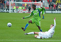 25 April 2010: Seattle Sounders forward Steve Zakuani #11 is slide tackled by Toronto FC defender Raivis Hscanovics #34 during a game between the Seattle Sounders and Toronto FC at BMO Field in Toronto..Toronto FC won 2-0....