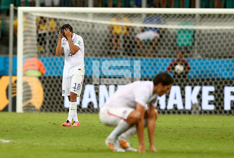 Chris Wondolowski of USA shows a look of dejection at full time as his side is eliminated from the World Cup