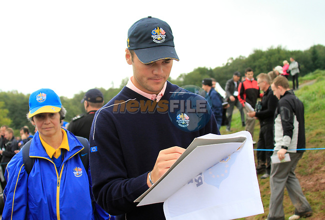 Martin Kaymer signs autographs during Practice Day 3 of the The 2010 Ryder Cup at the Celtic Manor, Newport, Wales, 29th September 2010..(Picture Eoin Clarke/www.golffile.ie)