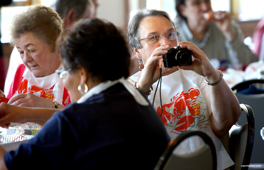 Ronna Hamelin, facing center, chairman of RCDC, of Newmarket takes pictures as former Ohio Gov. Ted Strickland, speaks at the Rockingham County Democratic Committee's annual Clambake, at the Portsmouth Elks Club in Portsmouth, N.H., Sunday, May 20, 2012.  (Portsmouth Herald Photo Cheryl Senter)