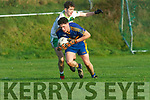 Darragh Behan St Senans holds onto the ball despite the attention of Jack Behan Ballydonoghue during the North Kerry Football final played in Moyvane on Sunday.
