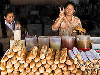 Colonial architecture and food are two of the lasting influences of the previous French colonisation of Laos. Delicious baguettes are a common item for sale in the markets.<br /> (Photo by Matt Considine - Images of Asia Collection)