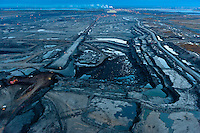 Twenty four hours a day the Tar Sands eats into the most carbon rich forest ecosystem on the planet. Storing almost twice as much carbon per hectare as tropical rainforests, the boreal forest is the planet's greatest terrestrial carbon storehouse. To the industry, these diverse and ecologically significant forests and wetlands are referred to as overburden, the forest to be stripped and the wetlands dredged and replaced by mines and tailings ponds so vast they can be seen from outer space.