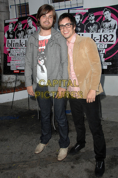 SPENCER SMITH & BRENDON URIE of Panic at The Disco.Blink-182 Tour Launch held at The El Compadre Restaurant, Los Angeles, California, USA..May 18th, 2009.full length jeans denim grey gray cardigan beige jacket glasses black .CAP/ADM/KB.©Kevan Brooks/AdMedia/Capital Pictures.