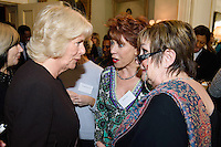 09 March 2016 - London, England - Camilla Duchess of Cornwall, President of WOW, speaks with the author Kathy Lette and British journalist Jenni Murray at a reception for the Women of the World Festival (WOW) at Clarence House, in central London. Photo Credit: Alpha Press/AdMedia
