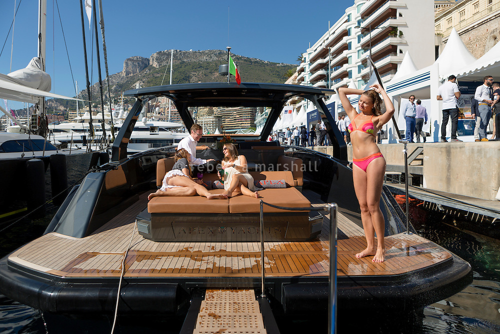 Irina Garber, founder of Apex Yachts, meets with Georg Decker and Mareid Petersen of yacht designers Egg & Dart on board an Apex yacht that they co-designed, Monaco Yacht Show, Monaco, 29 September 2016. Marina, an employee of Irina's, showers in the foreground.