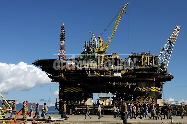 Construction of the Petrobras P51 platform, billed as the largest in the world, in Angra dos Reis, about 2 hours west of Rio de Janeio, Brazil. The platform is a landmark for Brazilian naval construction - it is the first semi-submersable built entirely in the country and will have 70% Brazilian components when finished.  The P51, the P52, which is already operating, and the future P56 all come from the same basic design and have given new life to the once dormant shipyard. As the price of oil continues to rise and Brazil strikes more and more extremely deep offshore oil, workers hope to keep their jobs for many years to come.(Australfoto/Douglas Engle)